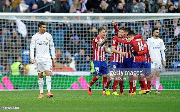 Cristiano Ronaldo of Real Madrid walks away from celebrating Atletico Madrid players after Atletico beat Real 10 in the La Liga match between Real...