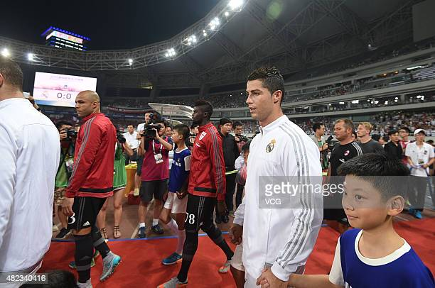 Cristiano Ronaldo of Real Madrid walks on to the pitch prior to the International Champions Cup football match between AC Milan and Real Madrid at...