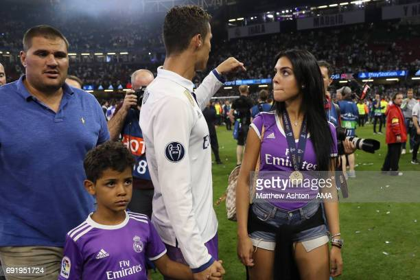 Cristiano Ronaldo of Real Madrid walks with girlfriend Georgina Rodriguez and son Cristiano Jnr at the end of the UEFA Champions League Final between...