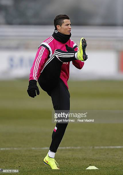 Cristiano Ronaldo of Real Madrid warms up during a training session at Valdebebas training ground on February 12 2015 in Madrid Spain