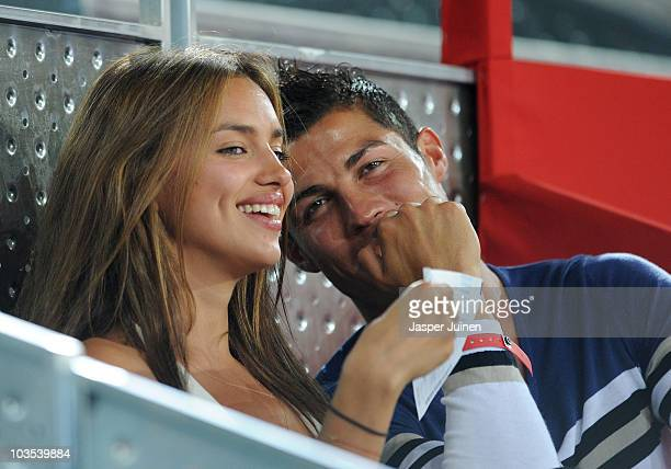 Cristiano Ronaldo of Real Madrid watches a friendly basketball between Spain and the USA with Irina Shayk at La Caja Magica on August 22, 2010 in...