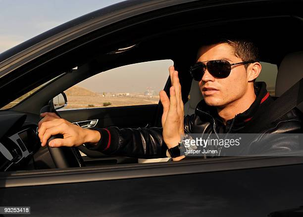 Cristiano Ronaldo of Real Madrid waves to his fans as he leaves the Valdebebas training ground on November 20, 2009 in Madrid, Spain. Ronaldo resumed...