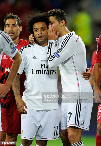 Cristiano Ronaldo of Real Madrid whispers in Marcelo's ear during the UEFA Super Cup Final between Real Madrid and Sevilla at the Cardiff City...