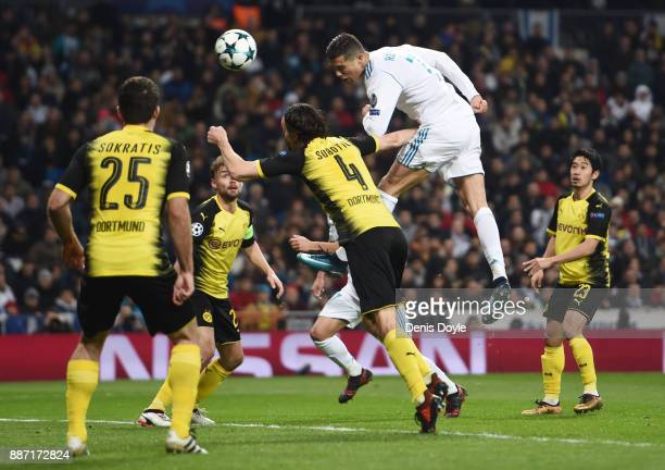 Cristiano Ronaldo of Real Madrid wins a header during the UEFA Champions League group H match between Real Madrid and Borussia Dortmund at Estadio...
