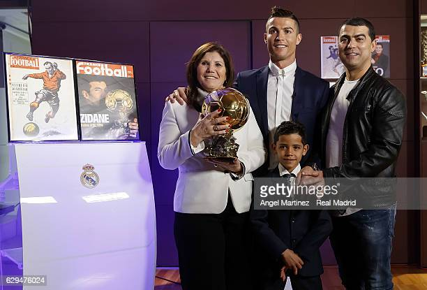 Cristiano Ronaldo of Real Madrid with his mother Maria Dolores dos Santos his son Cristiano Ronaldo Jr and his brother Hugo Aveiro pose with the...
