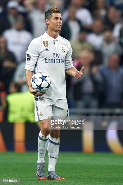 Cristiano Ronaldo of Real Madrid with the match ball after scoring a hattrick during the UEFA Champions League Semi Final first leg match between...