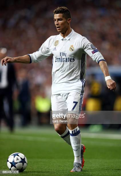 Cristiano Ronaldo of Real runs with the ball during the UEFA Champions League Semi Final first leg match between Real Madrid CF and Club Atletico de...
