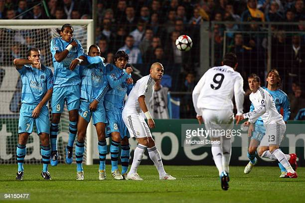 Cristiano Ronaldo of Real scores from a direct free kick during the Marseille v Real Madrid UEFA Champions League Group C match at the Stade...