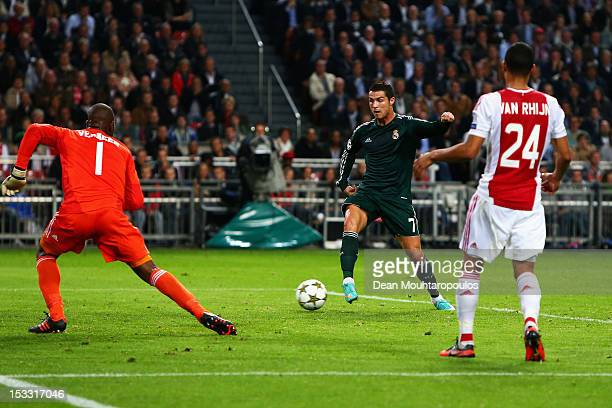 Cristiano Ronaldo of Real shoots and scores the first goal of the game during the UEFA Champions League Group D match between Ajax Amsterdam and Real...