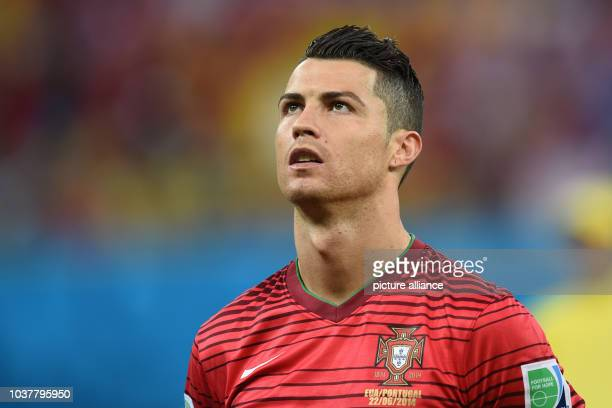 Cristiano Ronaldo of Ronaldo sings the national anthem prior to the FIFA World Cup 2014 group G preliminary round match between the USA and Portugal...