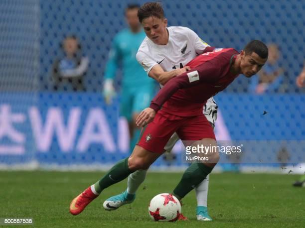 Cristiano Ronaldo of the Portugal national football team and Ryan Thomas of the New Zealand national football team vie for the ball during the 2017...