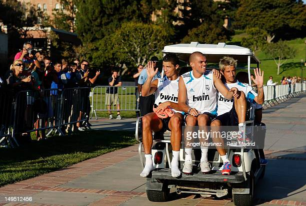 Cristiano Ronaldo Pepe and Fabio Coentrao of Real Madrid wave to the fans after a training session at UCLA campus on July 29 2012 in Los Angeles...