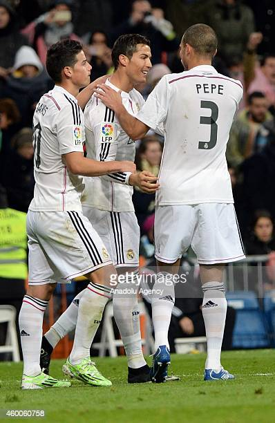 Cristiano Ronaldo Pepe and James of Real Madrid celebrate after Ronaldo's goal during the Spanish La Liga soccer match between Real Madrid and RC...
