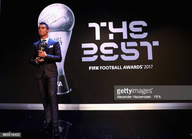 Cristiano Ronaldo pose for a photo after accepting The Best FIFA Men's Player award during The Best FIFA Football Awards at The London Palladium on...