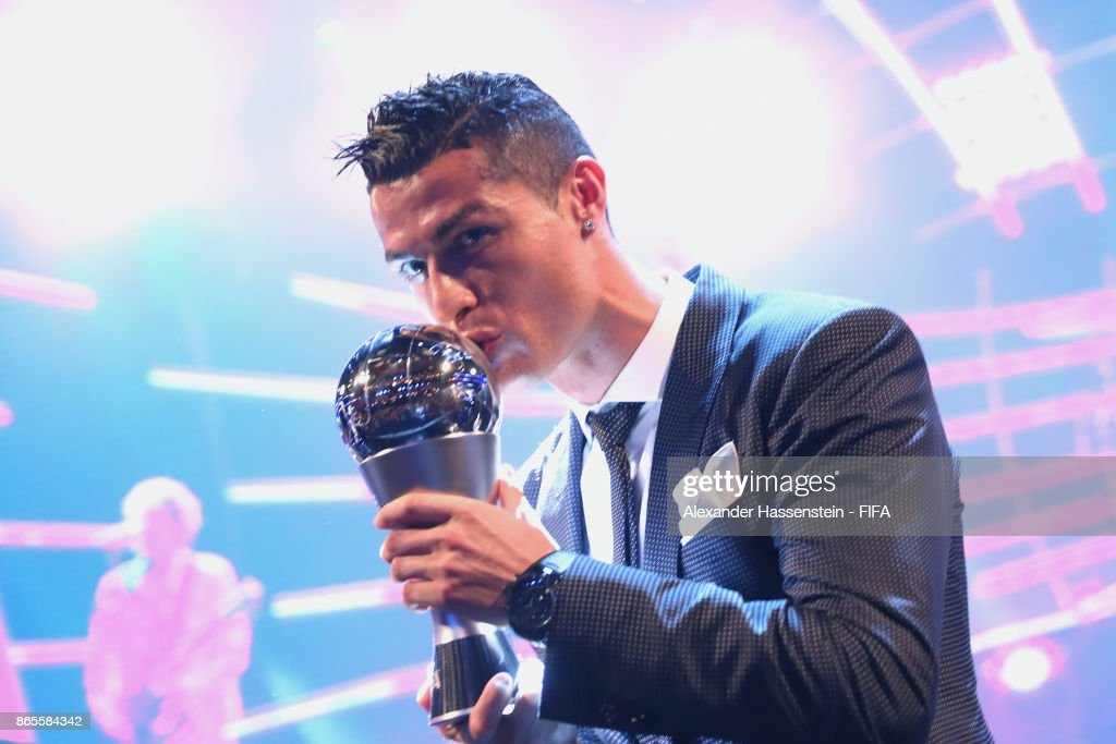 Cristiano Ronaldo pose for a photo after accepting The Best FIFA Men's Player award during The Best FIFA Football Awards at The London Palladium on October 23, 2017 in London, England.