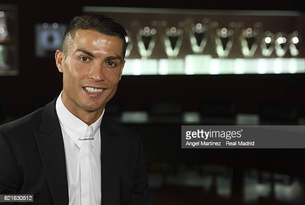Cristiano Ronaldo poses after signing a contract renewal until 2021 for Real Madrid FC at Santiago Bernabeu Stadium on November 7 2016 in Madrid Spain
