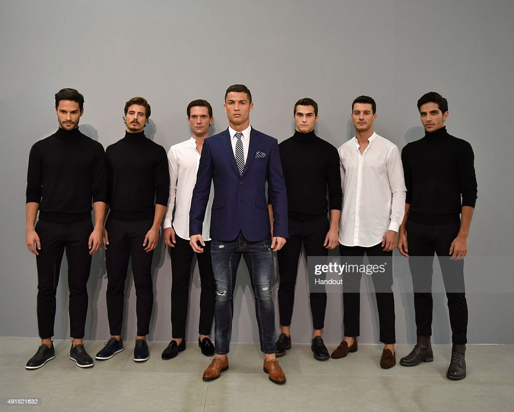 Cristiano Ronaldo poses alongside male models during a presentation of his new CR7 Footwear collection on October 5, 2015 in Guimaraes, Portugal.