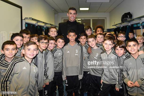 Cristiano Ronaldo poses for a photo during a visit to the Juventus youth sector on December 18 2018 in Turin Italy