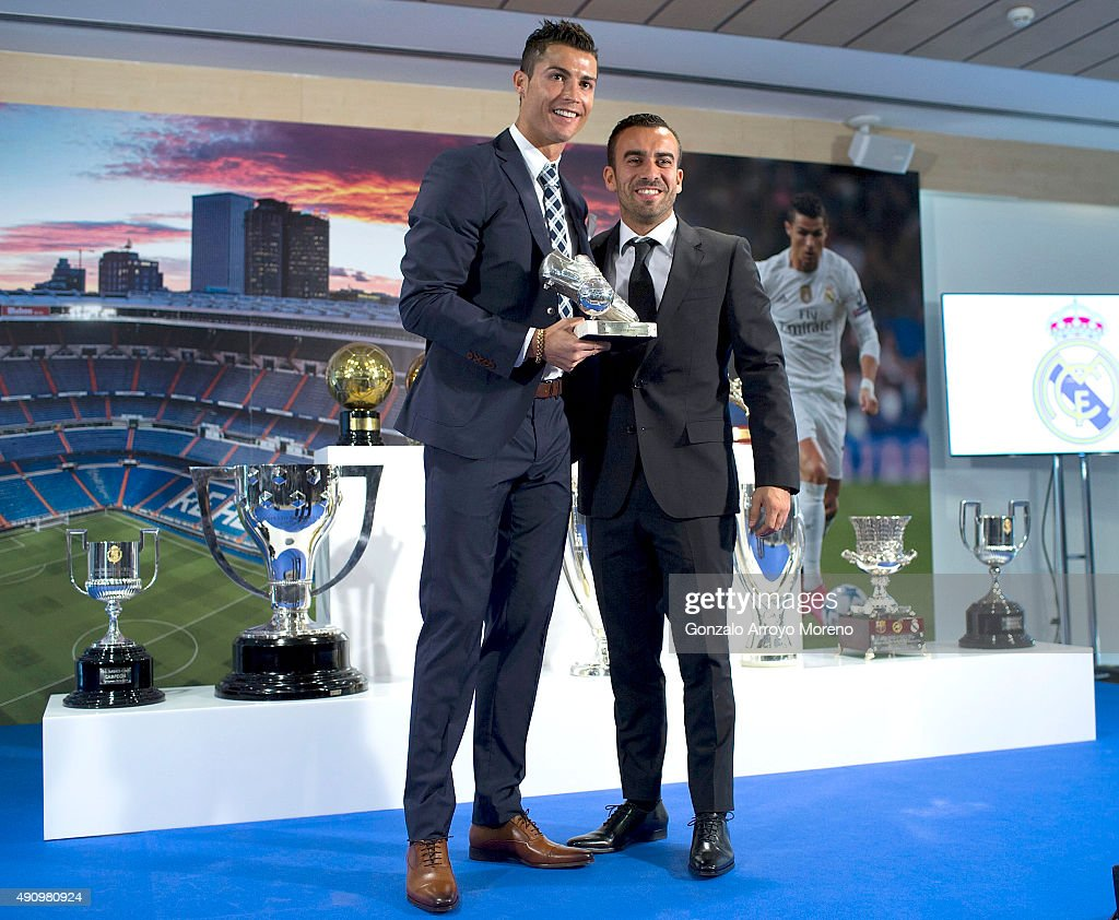 Cristiano Ronaldo (L) poses for a picture with his trophy as all-time top scorer of of Real Madrid CF and guest at Honour box-seat of Santiago Bernabeu Stadium on October 2, 2015 in Madrid, Spain. Portuguese palyer Cristiano Ronaldo overtook on his last UEFA Champions League match against Malmo FF Raul's record as Real Madrid all-time top scorer.