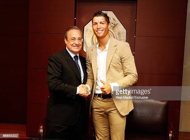 Cristiano Ronaldo poses next the President of Real Madrid Florentino Perez after the sign of his contract as new Real Madrid player at the Santiago...