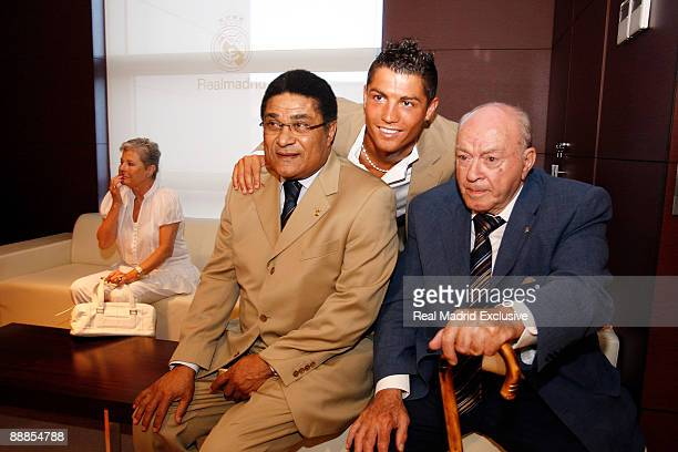 Cristiano Ronaldo poses whith the Honor President of Real Madrid Alfredo Di Stefano and Eusebio before sign his contract as new Real Madrid Player at...