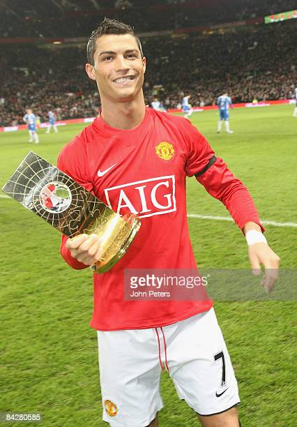 Cristiano Ronaldo poses with his FIFA World Player of the Year award ahead of the Barclays Premier League match between Manchester United and Wigan...