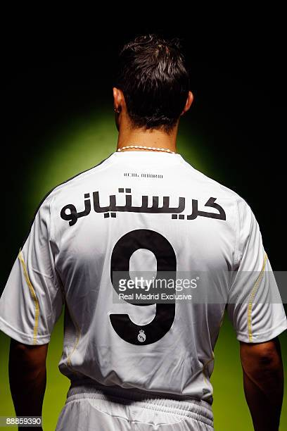 Cristiano Ronaldo poses with his new Real Madrid shirt with his name displayed in Arabian before his official presentation at the Santiago Bernabeu...