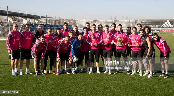 Cristiano Ronaldo poses with his teammates with his Ballon d'Or trophy at Valdebebas training ground on January 13 2015 in Madrid Spain