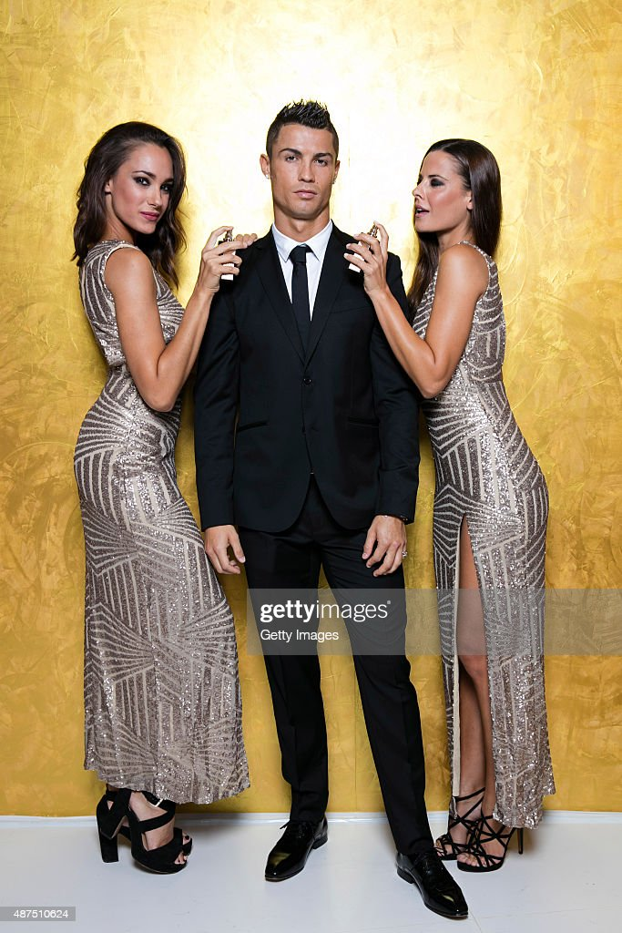 Cristiano Ronaldo poses with models as he unveils his debut fragrence 'Cristiano Ronaldo Legacy' at a launch party on September 9, 2015 in Madrid, Spain.