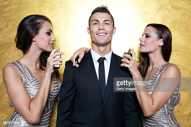 Cristiano Ronaldo poses with models as he unveils his debut fragrence 'Cristiano Ronaldo Legacy' at a launch party on September 9 2015 in Madrid Spain
