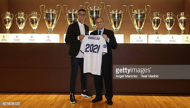 Cristiano Ronaldo poses with president Florentino Perez after signing a fiveyear contract renewal until 2021 for Real Madrid FC at Santiago Bernabeu...