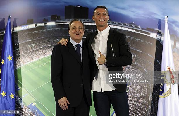 Cristiano Ronaldo poses with president Florentino Perez after signing a contract renewal until 2021 for Real Madrid FC at Santiago Bernabeu Stadium...