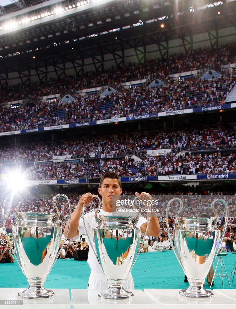 Cristiano Ronaldo poses with three European Cups during his official presentation as a new Real Madrid player at the Santiago Bernabeu Stadium on July 6, 2009 in Madrid, Spain.
