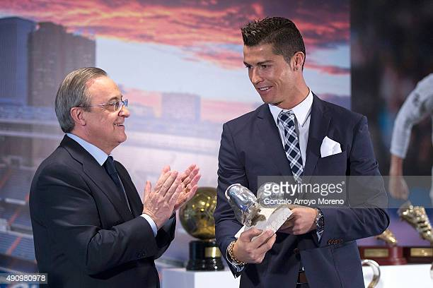 Cristiano Ronaldo receives the trophy as alltime top scorer of Real Madrid CF from president Florentino Perez at Honour boxseat of Santiago Bernabeu...