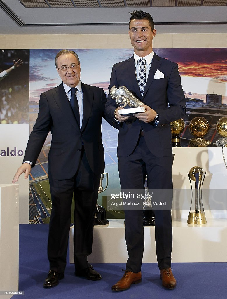 Cristiano Ronaldo (R) receives the trophy as all-time top scorer of Real Madrid CF from president Florentino Perez (R) at Honour box-seat of Santiago Bernabeu Stadium on October 2, 2015 in Madrid, Spain. Portuguese player Cristiano Ronaldo overtook Raul's goal scoring record on his last UEFA Champions League match against Malmo FF to become Real Madrid's all-time top scorer.