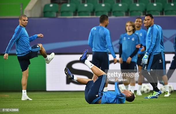 Cristiano Ronaldo rolls on the turf during a Real Madrid training session ahead of their UEFA Champions League quarter final first leg match against...