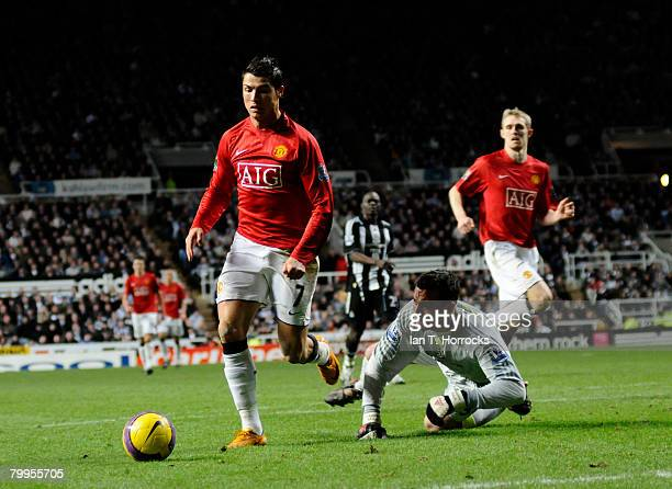 Cristiano Ronaldo rounds Steve harper for Manchester United's third goal during the Barclays Premier match between Newcastle United and Manchester...