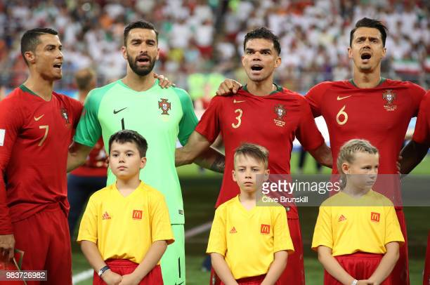 Cristiano Ronaldo Rui Patricio Pepe and Jose Fonte of Portugal sing the national anthem prior to the 2018 FIFA World Cup Russia group B match between...