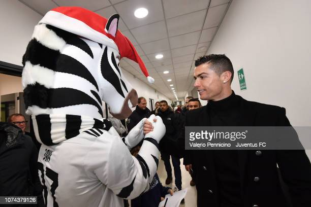Cristiano Ronaldo salutes Jay during a visit to the Juventus youth sector on December 18 2018 in Turin Italy