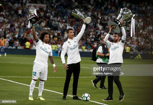 Cristiano Ronaldo Sergio Ramos and Marcelo of Real Madrid greet the fans with their 2016/2017 Champions League La Liga and Bernabeu trophies ahead of...