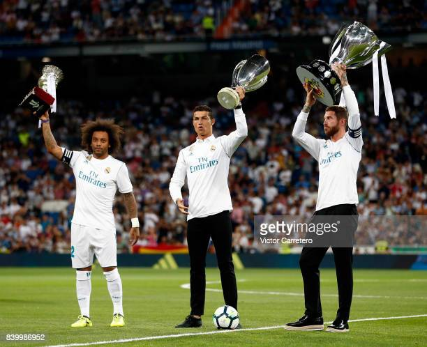 Cristiano Ronaldo Sergio Ramos and Marcelo of Real Madrid poses with Spanish Super Cup European Super Cup and La Liga trophies before the La Liga...