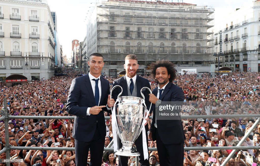 Cristiano Ronaldo (L), Sergio Ramos (C) and Marcelo Real Madrid celebrate their UEFA Champions League victory at Puerta del Sol on June 4, 2017 in Madrid, Spain.