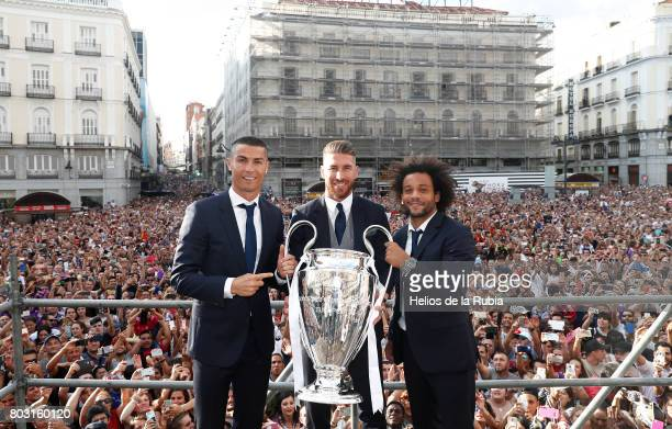 Cristiano Ronaldo Sergio Ramos and Marcelo Real Madrid celebrate their UEFA Champions League victory at Puerta del Sol on June 4 2017 in Madrid Spain