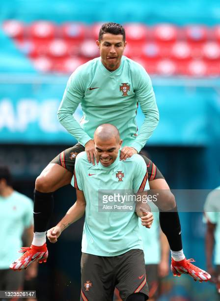 Cristiano Ronaldo shares a joke with Pepe during the Portugal Training Session ahead of the UEFA Euro 2020 Group F match between Hungary and Portugal...