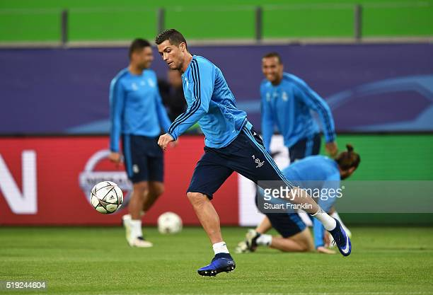 Cristiano Ronaldo shoots during a Real Madrid training session ahead of their UEFA Champions League quarter final first leg match against Wolfsburg...