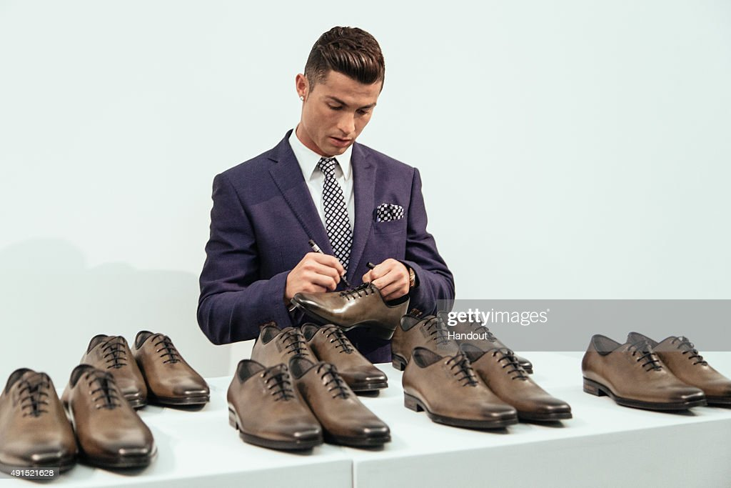 Cristiano Ronaldo signs 10 pairs of CR7 Footwear during the global launch of his FW15 collection. Each pair will be put in to circulation to be purchased at random by lucky consumers around the world on October 5, 2015 in Guimaraes, Portugal.