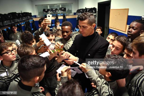 Cristiano Ronaldo signs autographs during a visit to the Juventus youth sector on December 18 2018 in Turin Italy