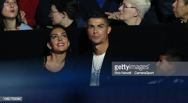 Cristiano Ronaldo sits in the corporate seats with his girlfriend Georgina Rodriguez during Day Two of the Nitto ATP Finals at The O2 Arena on...