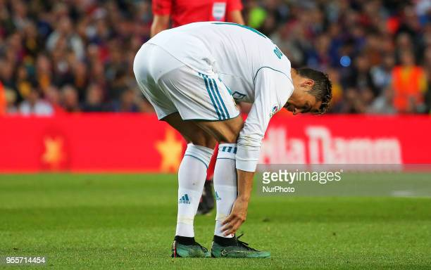Cristiano Ronaldo suffers from an injury after scoring a goal during the match between FC Barcelona and Real Madrid CF played at the Camp Nou Stadium...