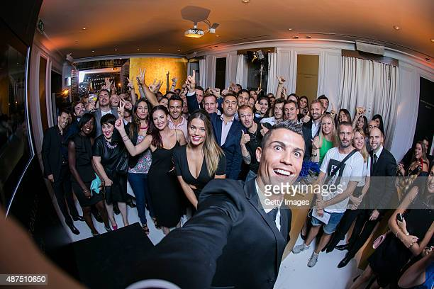 Cristiano Ronaldo takes a selfie as he unveils his debut fragrence 'Cristiano Ronaldo Legacy' at a launch party on September 9 2015 in Madrid Spain